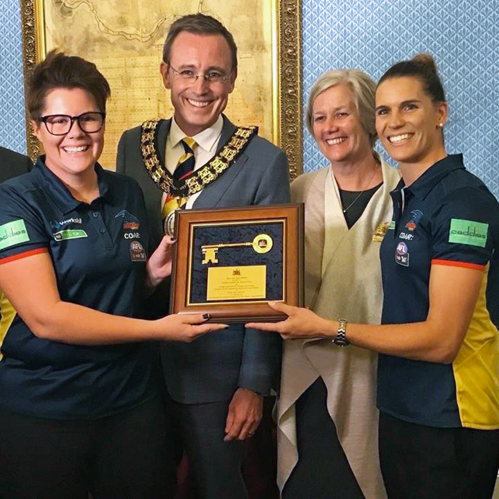 Innaugural AFLW Premiers Adelaide Crows women's team recieve the keys to the city from Deputy Lord Mayor Megan Hender and Lord Mayor Martin Haese
