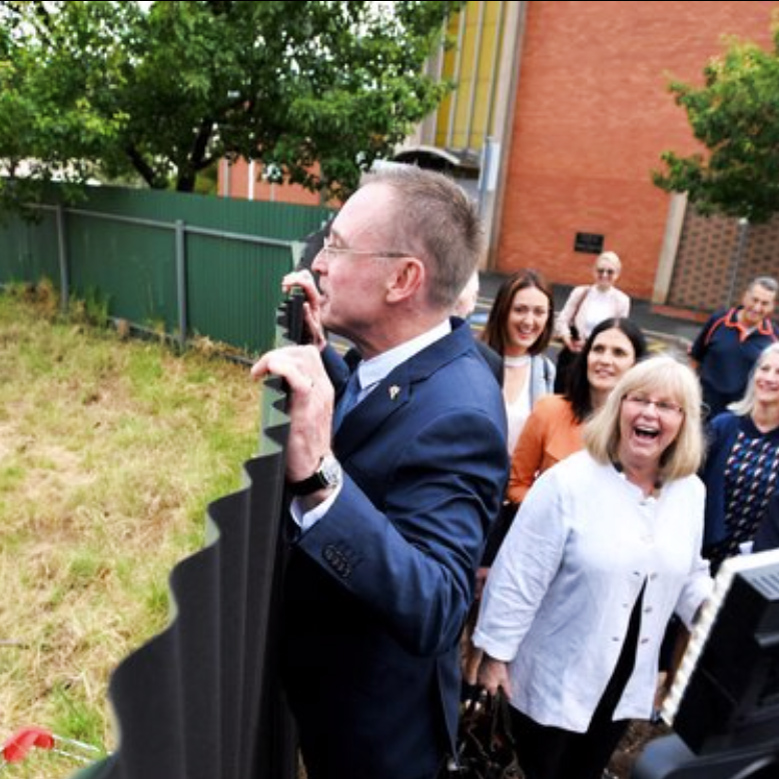 Lord Mayor Martin Haese peers over the fence of the former LeCornus site 88 O'Connell Street North Adelaide