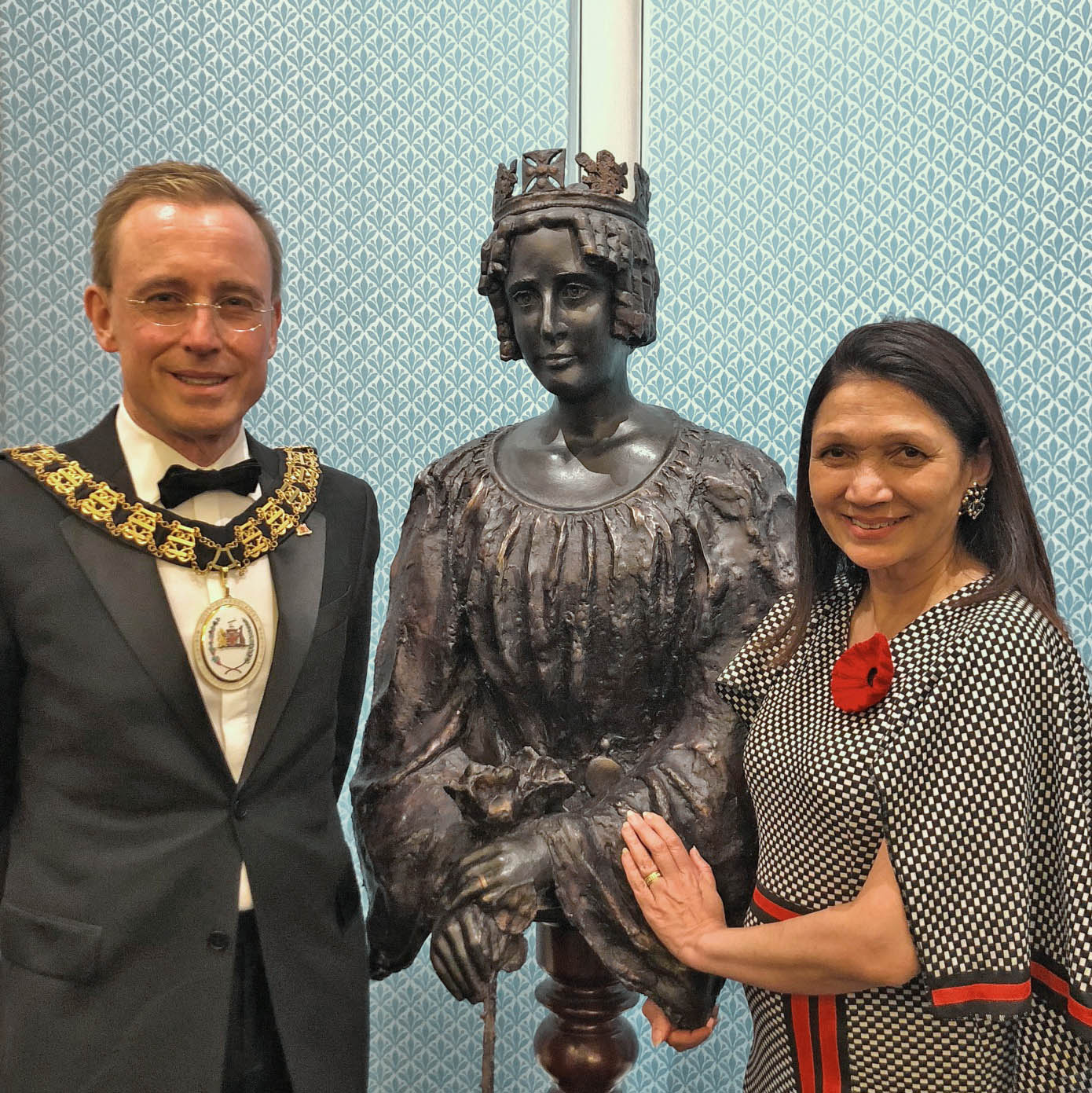 Lord Mayor Martin Haese with Lady Mayoress Genevieve Theseira-Haese with a statue of Queen Adelaide by local sculptor Scott Eames