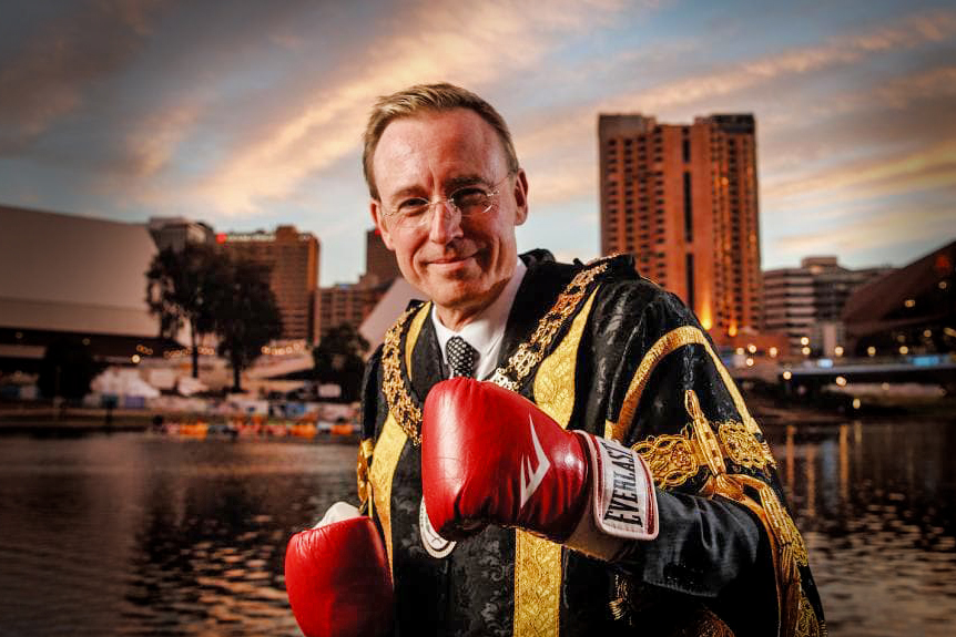 Lord Mayor Martin Haese on the Torrens Riverbank wearing boxing gloves
