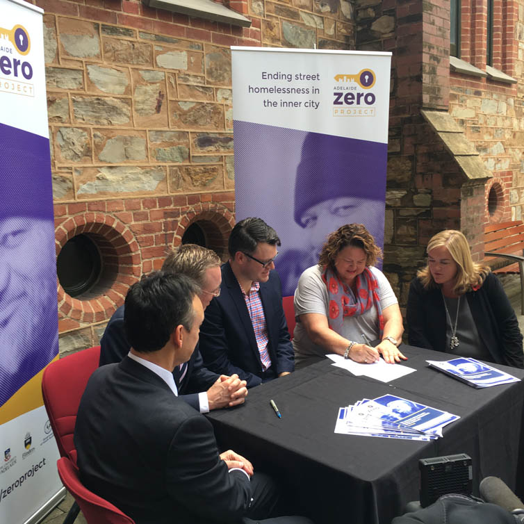 Lord Mayor Martin Haese signs the memorandum of understanding for the Zero Adelaide Project Joe Formichella David Pearson the Honourable Nat Cook and Dame Louise Casey from the Institute For Global Homelessness and the Don Dunstan Foundation