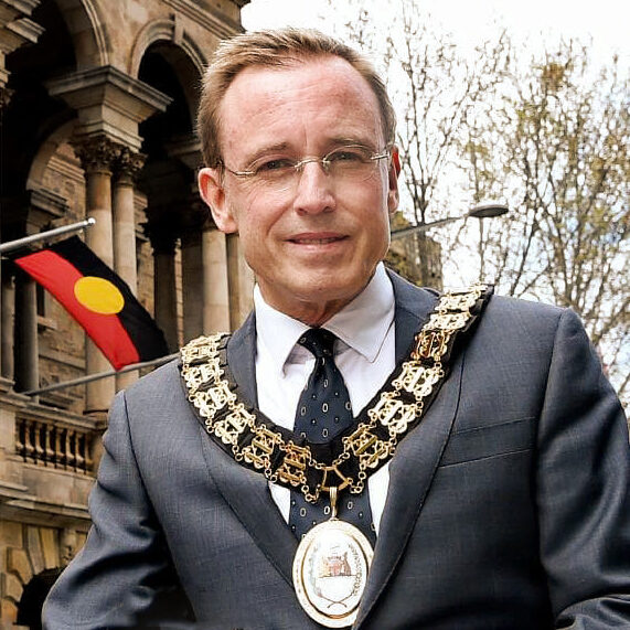 Lord Mayor Martin Haese at Adelaide Town Hall with Kaurna Flag