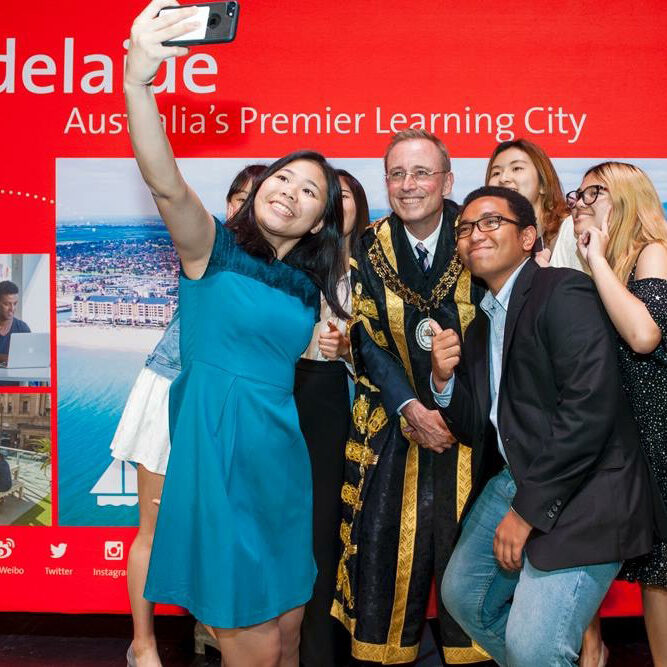 Lord Mayor Martin Haese poses for a 'selfie' with international students, StudyAdelaide